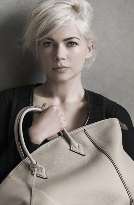 Бежевая сумка от Louis Vuitton