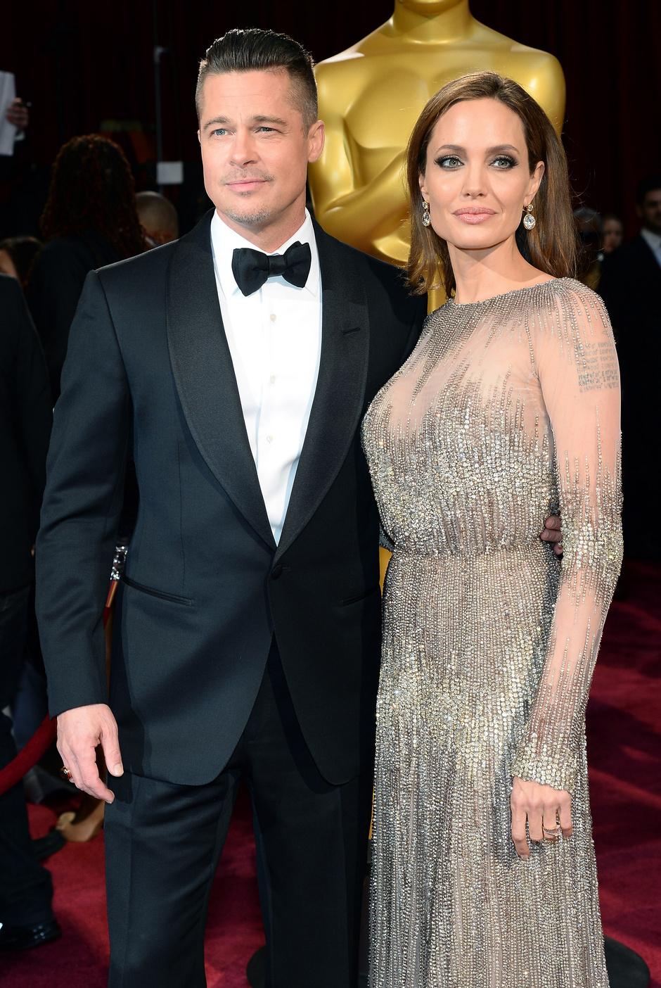 Анджелина Джоли и Брэд Питт на церемонии «Оскар» в 2014 году