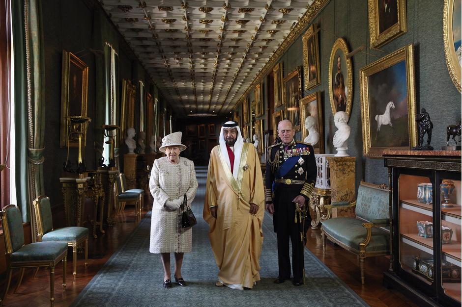 Елизавета II, шейх Халифа бен Заид Аль Нахайян и принц Филипп